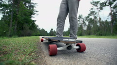 Pick up longboard low angle slow motion Stock Footage