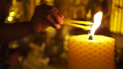 Hands Lighting Candles at Buddhist Temple in Chiang Mai, Thailand Stock Footage