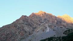 Mountain in the light of the rising sun. Time Lapse. Pamir, Tajikistan Stock Footage