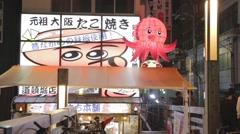 Cute octopus mascot outside restaurant - Dotonbori night Stock Footage