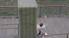 Man paints at Dotonbori canal Stock Footage