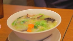 A hot bowl of vegetarian Japanese noodle soup Stock Footage
