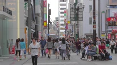 Busy street at Dotonbori day - forever 21 pan Stock Footage