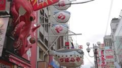 Big octopus and blow fish signs tilt dotonbori Stock Footage