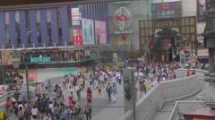 Aerial angle - crowds walk into Shin sai bashi suji at Dotonbori Stock Footage