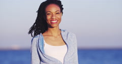 African woman smiling and holding hair Stock Footage