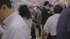 Japanese business man checks cellphone on train Stock Footage
