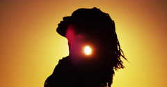 Beautiful Silhouette of African woman standing at sunset Stock Footage