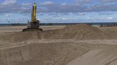 Excavator digging a trench at construction site Stock Footage