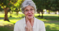 Senior woman blowing kisses at camera Stock Footage