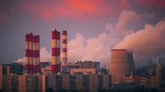 Smoke pollution from power plant smokestacks over urban cityscape. HD timelapse. Stock Footage