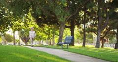 Grandma walking at the park Stock Footage