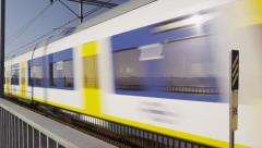 Sprinter Train passing by at High Speed Stock Footage