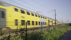 Dutch Double Carriage train passing by Stock Footage