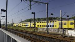 Two trains pass each other on the bridge - stock footage