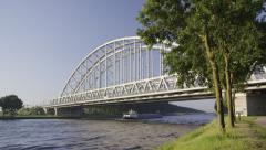Large classic steel railroad bridge in the Netherlands Stock Footage