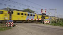 Railroad crossing with train Stock Footage