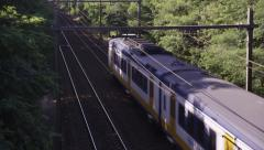 Sprinter train passing underneath Stock Footage
