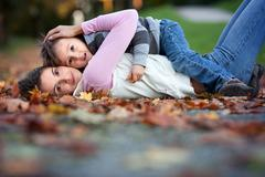 Young mom with her little boy in the park Stock Photos