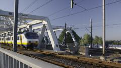Dutch Railways train passing the classic steel bridge Stock Footage