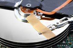 Hard disk failure with a band-aid over disks Stock Photos