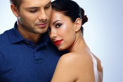 portrait of a young beautiful couple hugging - stock photo