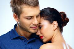 portrait of a beautiful couple hugging - stock photo