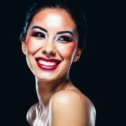 Stock Photo of portrait of a cheerful young woman on black background