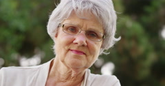 Mature woman smiling and looking at camera Stock Footage