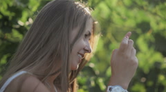 Beautiful girl takes pictures on the phone in the vineyards Stock Footage