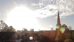 Epic Sun Lens Flare Over Spires Lichfield Cathedral Beautiful Morning Light Pan Stock Footage