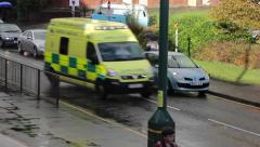 Traffic Cars Stop for Ambulance, Police Car Queues at Rush Hour Lights Rainy Day Stock Footage