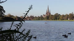 Beautiful View of Lichfield Cathedral Over Stowe Pool with Ducks Stock Footage