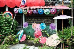 colorful handmade umbrella for sale - stock photo