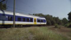 Dutch Railways slow train passing Stock Footage
