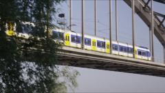 Reveal shot of train on classic steel bridge Stock Footage