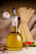 olive oil for seasoning pasta - stock photo