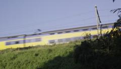 Dutch Railways train passing on embankment Stock Footage