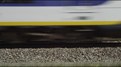 Close up of Dutch Railways train passing Stock Footage