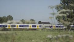 Dutch Railways train and flower rackfocus Stock Footage