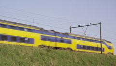 Intercity train passing by on embankment - stock footage