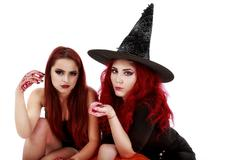 Two redheads women with bloody hands halloween scene Stock Photos