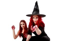 two redheads women with bloody hands halloween scene - stock photo