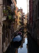 Venice Waterway in Sunshine and a Blue Boat Stock Photos