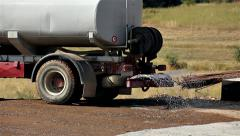 Water truck sprays water on a soil Stock Footage