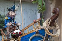 Old Captain and his boat - stock photo