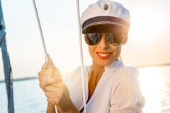 Sexy model on a boat at sunset. Stock Photos