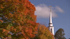 New england church steeple in brilliant fall color Stock Footage