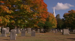 New england cemetery and church in brilliant fall color Stock Footage