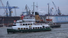 Ferry boats closeup touring in Hamburg harbour Stock Footage